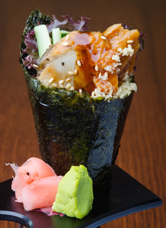 japanese cuisine. hand roll on background photo