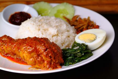 Nasi lemak traditional malaysian spicy rice dish photo