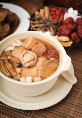 meat dish: abalone and herb soup in pot, Chinese food style