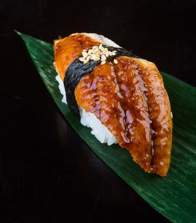 japanese cuisine. sushi unagi on background photo