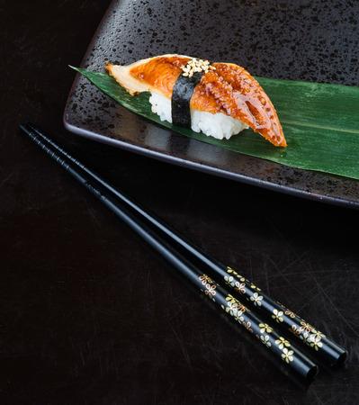 日本の料理。背景に寿司うなぎ