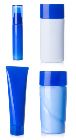 cosmetics bottles set on white background photo