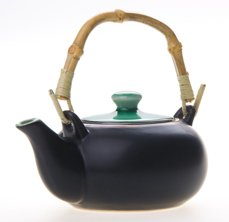 chinese teapot. ceramic teapot on background. photo