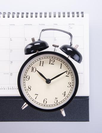 alarm clock with calendar. alarm clock with calendar on background photo