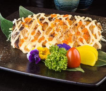 japanese cuisine. fried fish on background photo