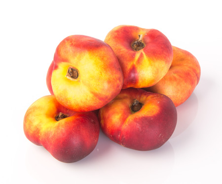 donut peaches. flat peaches on the background photo
