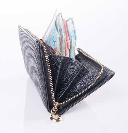 wallet. woman wallet with money on background photo