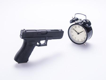 alarm clock with guns. alarm clock with guns on background. photo