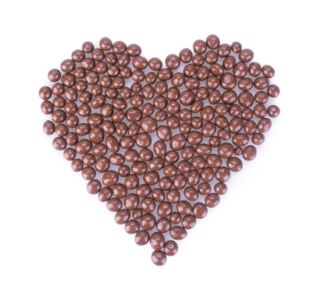 chocolate balls. chocolate balls in love shape on a background. photo