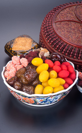 preserved fruits. chinese preserved fruits on background photo
