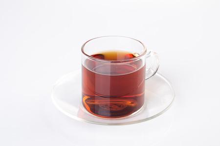 tea mug: Tea in glass cup on a background. Tea in glass cup on a background.