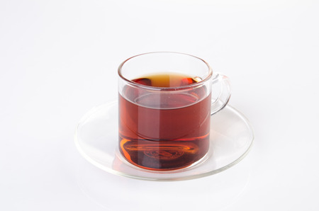 Tea in glass cup on a background. Tea in glass cup on a background.