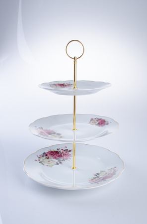 tray. three tier serving tray on a background
