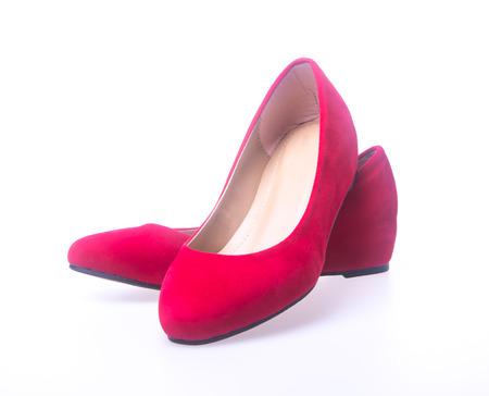 Zapatos rojos de mujer de moda en el fondo blanco Foto de archivo - 40890608
