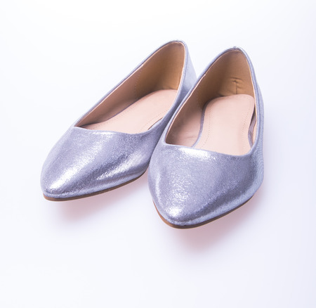 Silver colour fashion woman shoes on white background photo