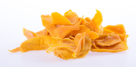 mango dry or dried mango slices on background Фото со стока