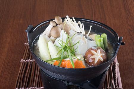 japanese cuisine: japanese cuisine. hot pot on background