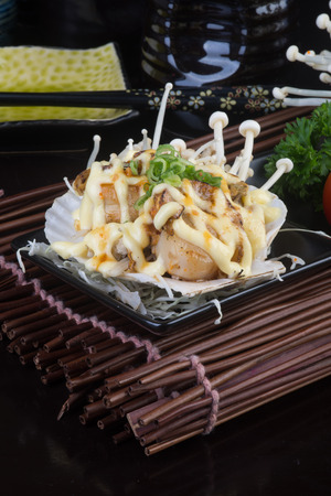 shell fish: japanese cuisine. grilled shell fish on background