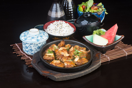 japanese people: japanese cuisine. hot plate chicken on background