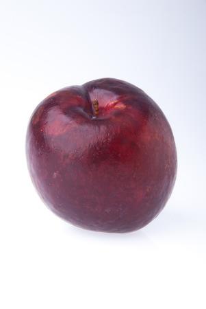 velvety: Plum. Ripe plum fruit on the white background