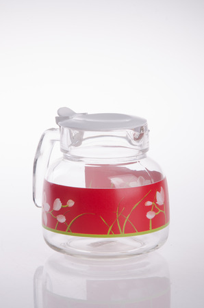 glass of water: glass water jug on white background. Stock Photo