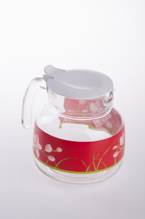 glas water: glass water jug on white background. Stockfoto