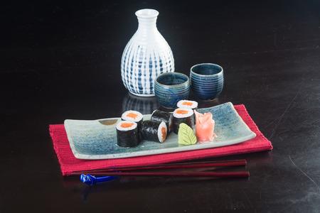 sake maki: japanese cuisine. sushi on background