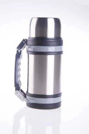 insulated drink container: Thermo flask on the background. Foto de archivo