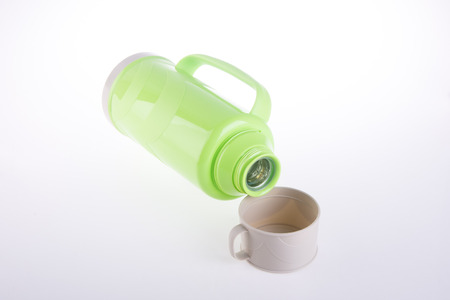 insulated drink container: Thermo, Plastic Thermo flask on the background.