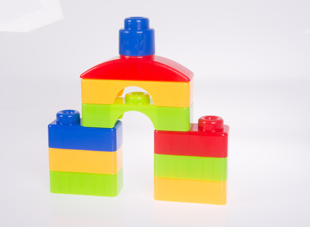 yellow lego block: toy. Plastic toy blocks on the background.