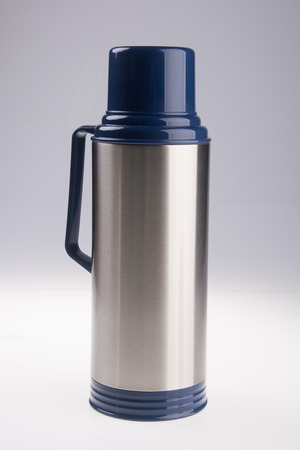 flask: Thermo flask. Thermo flask on the background Stock Photo