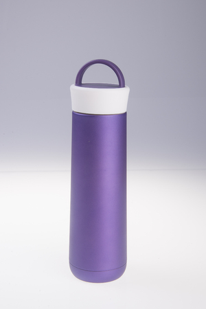 insulated drink container: Thermo flask. Thermo flask on the background Stock Photo