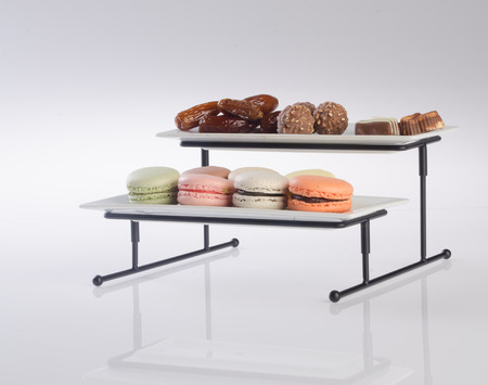 tier: tray. three tier serving tray on a background