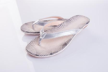 female soles: shoe. female fashion sandal on Background Stock Photo