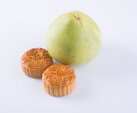 pummelo: Mooncake and Pummelo. mooncake & Fresh Pummelo on background. Stock Photo