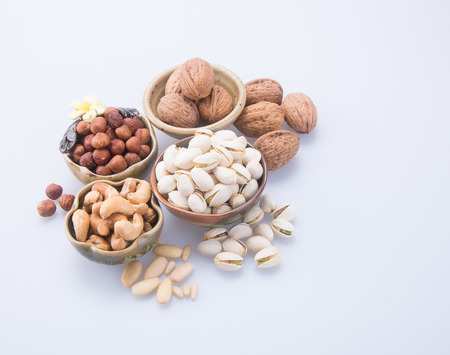 mixed nuts: nuts. mixed nuts on background Stock Photo