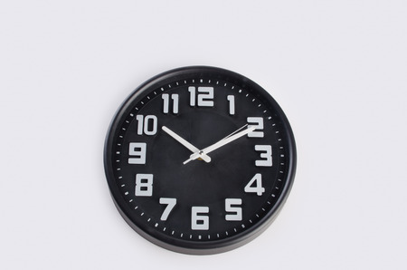 clock: clock or wall clock . wall clock on a background Stock Photo