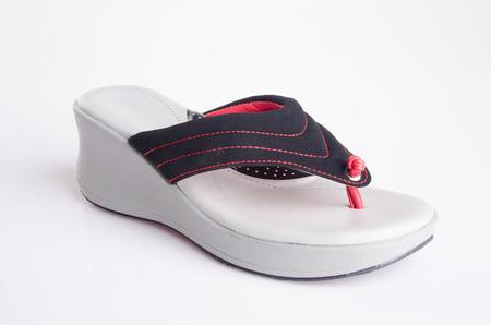 sandal: zapato. mujer de la sandalia en el fondo. Mujer en un fondo de s�ndalo