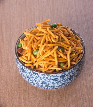 muruku: murukku or traditional indian snack chakli and chakali on background
