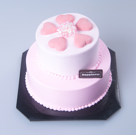 cake pick: cake or mothers day heart shaped cake on a background