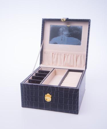 jewelery: jewelry box or leather jewelery box on background Stock Photo