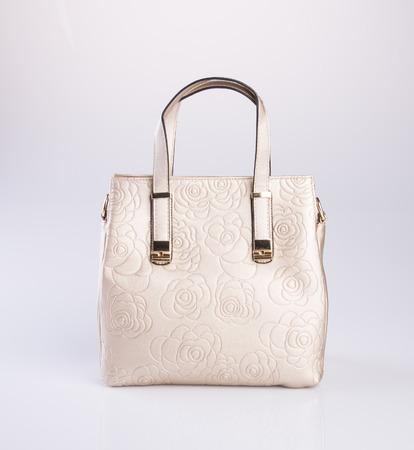 gold colour: bag or gold colour handbag on background Stock Photo