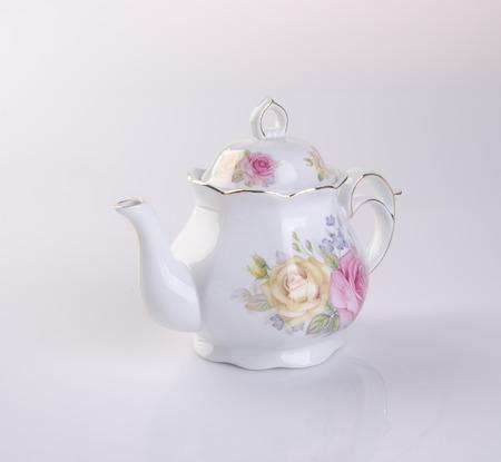 scald: tea pot or ceramic teapot on background
