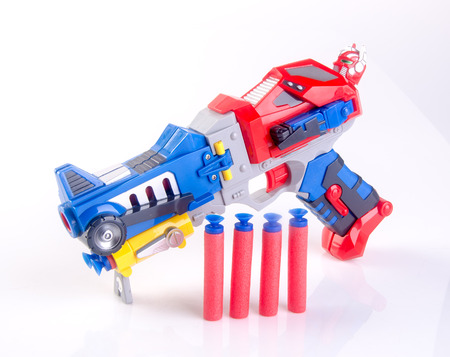 toy gun or toy dart gun on background