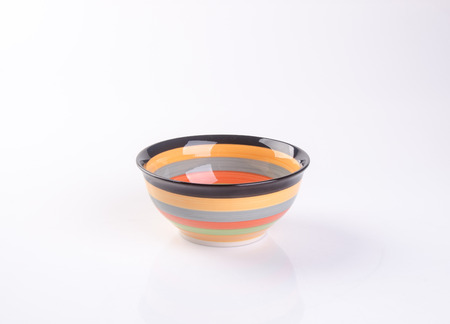 precarious: bowl or ceramic bowl on a background