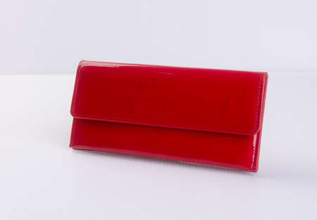 outmoded: wallet or purse woman (red colour) on a background