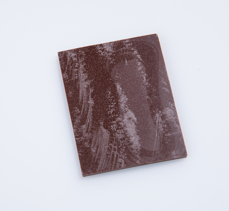 shiver: Chocolate bar or pieces on a background Stock Photo