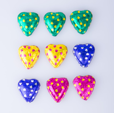 Chocolate or Colorful heart shape chocolate on a background
