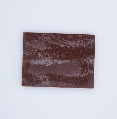 spall: Chocolate bar or pieces on a background Stock Photo