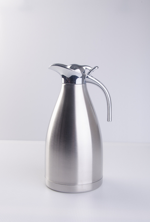 thermo: Thermo or Thermo flask from stainless stee on background